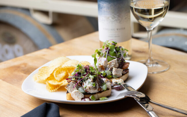 Chicken salad with glass of white wine